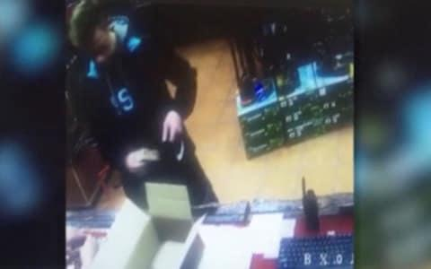 CCTV footage shows Vladislav Roslyakov putting firearm shells into a backpack at an arms shop several days before the attack - Credit: REUTERS