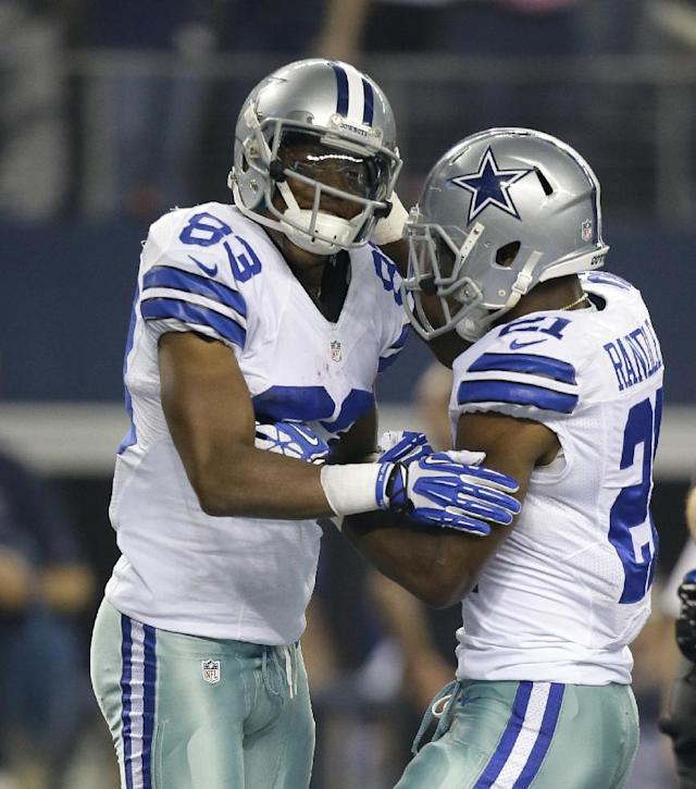 Dallas Cowboys wide receiver Terrance Williams (83) and running back Joseph Randle (21) celebrate after Williams grabbed a pass from Tony Romo for a touchdown in the second half of an NFL football game against the Washington Redskins, Sunday, Oct. 13, 2013, in Arlington, Texas. (AP Photo/Tim Sharp)