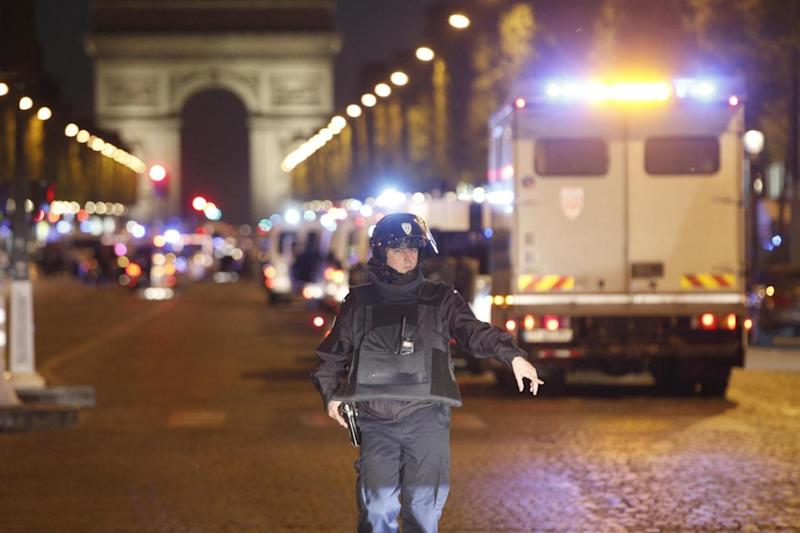 Blocked: The Champs Elysee Avenue is protected during ongoing police investigation (AP)