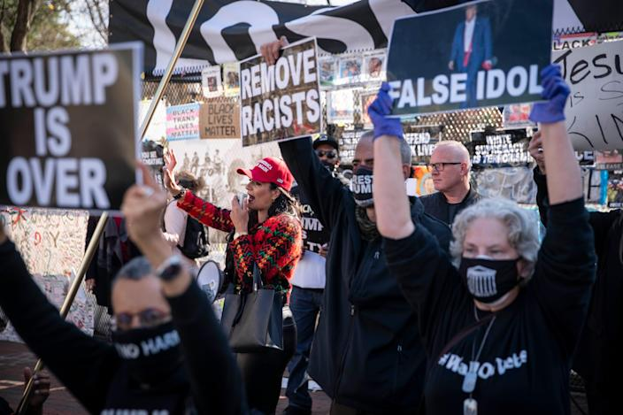 <p>Supporters of U.S. President Donald Trump and counter protesters demonstrate outside of the White House ahead of Saturday's Million MAGA March</p> (Getty Images)