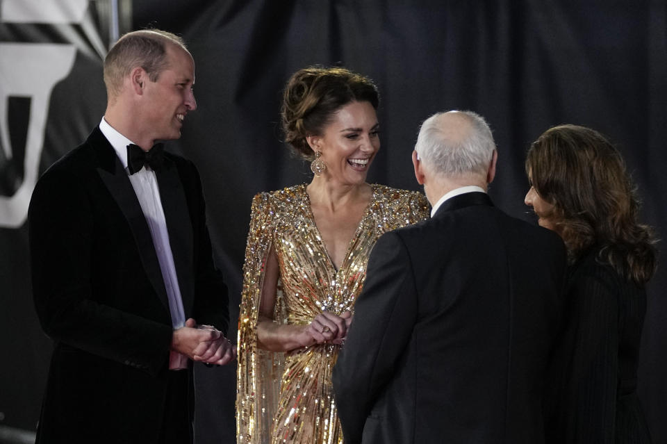 Britain's Prince William, from left, and his wife Kate the Duchess of Cambridge speak with Michael G. Wilson and Barbara Broccoli upon arrival for the World premiere of the new film from the James Bond franchise 'No Time To Die', in London Tuesday, Sept. 28, 2021. (AP Photo/Matt Dunham)
