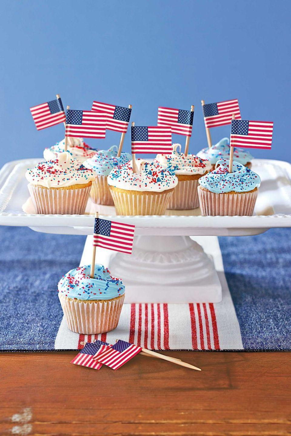 """<p>Red and blue sprinkles — plus mini American flags — add the perfect all-star touch to these <a href=""""https://www.goodhousekeeping.com/food-recipes/a28565483/vanilla-cupcakes-recipe/"""" rel=""""nofollow noopener"""" target=""""_blank"""" data-ylk=""""slk:classic vanilla cupcakes"""" class=""""link rapid-noclick-resp"""">classic vanilla cupcakes</a>.</p><p><em><a href=""""https://www.countryliving.com/food-drinks/recipes/a28340/patriotic-cupcakes-121077/"""" rel=""""nofollow noopener"""" target=""""_blank"""" data-ylk=""""slk:Get the recipe from Country Living »"""" class=""""link rapid-noclick-resp"""">Get the recipe from Country Living »</a></em> </p>"""