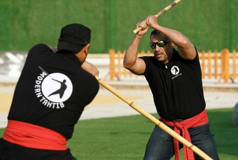 Youths take part in a training session of Egypt's combative sport of 'tahtib' (stick-fighting), in the capital Cairo