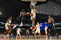 Jared Harper #1 of the Auburn Tigers passes to Anfernee McLemore #24 of the Auburn Tigers around Mamadi Diakite #25 of the Virginia Cavaliers during the first half of the semifinal game in the NCAA Men's Final Four at U.S. Bank Stadium on April 06, 2019 in Minneapolis, Minnesota. (Photo by Jamie Schwaberow/NCAA Photos via Getty Images)