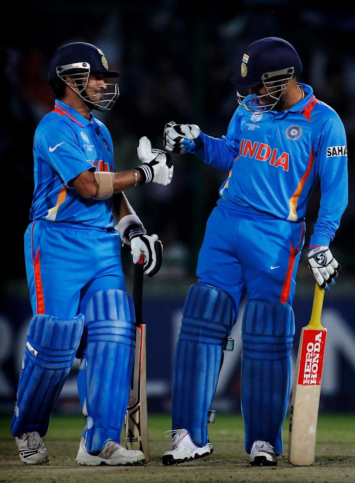 DELHI, INDIA - MARCH 09: Sachin Tendulkar and Virender Sehwag of India bump fists during the 2011 ICC Cricket World Cup Group B match between India and the Netherlands at Feroz Shah Kotla stadium on March 9, 2011 in Delhi, India.  (Photo by Daniel Berehulak/Getty Images)