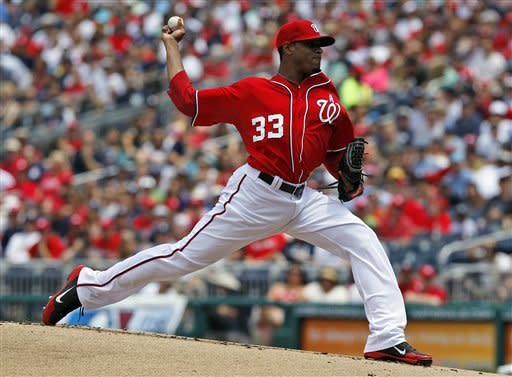 Washington Nationals starting pitcher Edwin Jackson throws during the first inning of a baseball game with the New York Yankees at Nationals Park, Sunday, June 17, 2012, in Washington. (AP Photo/Alex Brandon)