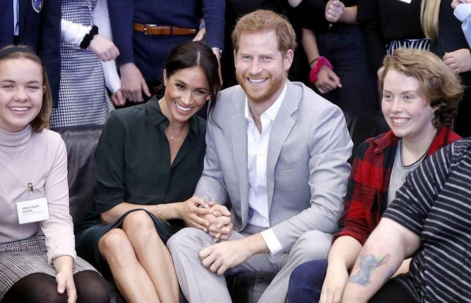 <p>During their busy schedule on their trip to Sussex, the pair sat next to each other and held a firm grip of each other's hands. *Sigh*. </p>