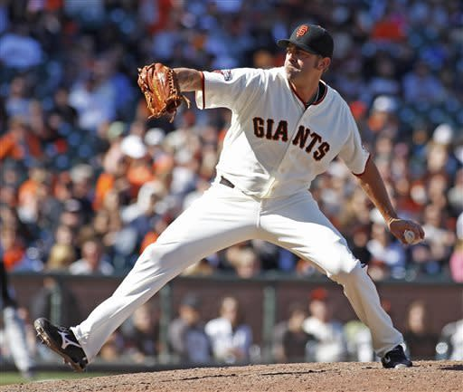 San Francisco Giants pitcher Jeremy Affeldt throws to the Colorado Rockies during the ninth inning of a baseball game on Sunday, May 26, 2013, in San Francisco. (AP Photo/George Nikitin)