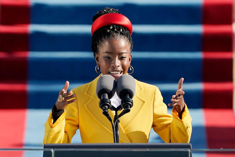 """Amanda Gorman recites her poem,""""The Hill We Climb,"""" in a Prada coat and headband during Wednesday's inauguration ceremony. (Photo: Pool via Getty Images)"""