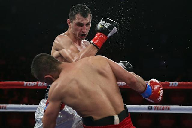 Viktor Postol throws a right hand at Selcuk Aydin, at The Forum in Inglewood, California, in May 2014 (AFP Photo/Jeff Gross)