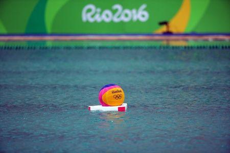2016 Rio Olympics - Water Polo - Preliminary - Men's Preliminary Round - Group A Australia v Japan - Maria Lenk Aquatics Centre - Rio de Janeiro, Brazil - 10/08/2016. A ball is seen in the pool where the water turned green. REUTERS/Kai Pfaffenbach