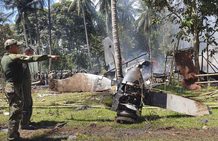 In this photo released by the Joint Task Force - Sulu, parts of a Lockheed C-130 Hercules plane are seen at the crash site in Patikul town, Sulu province, southern Philippines, Sunday July 4, 2021. Philippine troops found the last five dead from the crash of the transport aircraft in the south, raising the death toll to 50 in the military's worst air disaster, officials said Monday. (Joint Task Force-Sulu via AP)