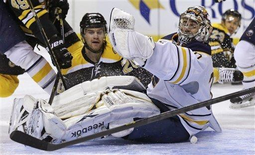 Buffalo Sabres goalie Ryan Miller, right, gloves a save as Boston Bruins left wing Daniel Paille, left, watches during the second period of an NHL hockey game in Boston, Thursday, Jan. 31, 2013. (AP Photo/Charles Krupa)