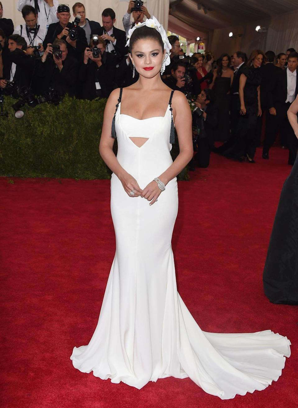 """<p>Selena <a href=""""https://www.popsugar.com/celebrity/Selena-Gomez-Met-Gala-2015-Pictures-37411357"""" class=""""link rapid-noclick-resp"""" rel=""""nofollow noopener"""" target=""""_blank"""" data-ylk=""""slk:stole the show at the Met Gala"""">stole the show at the Met Gala</a> in a backless white Vera Wang gown. It's official, folks: she's all grown up.</p>"""