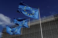 FILE PHOTO: European Union flags flutter outside the European Commission headquarters in Brussels, Belgium