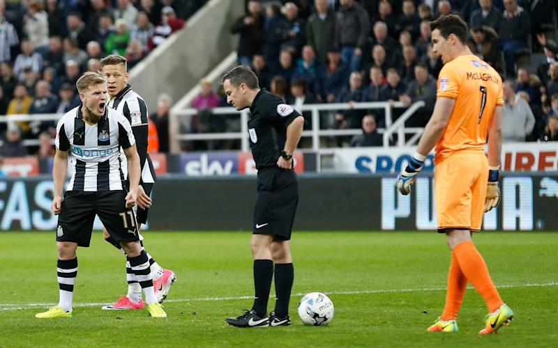 Matt Ritchie remonstrates with referee Keith Shroud  - PA Wire
