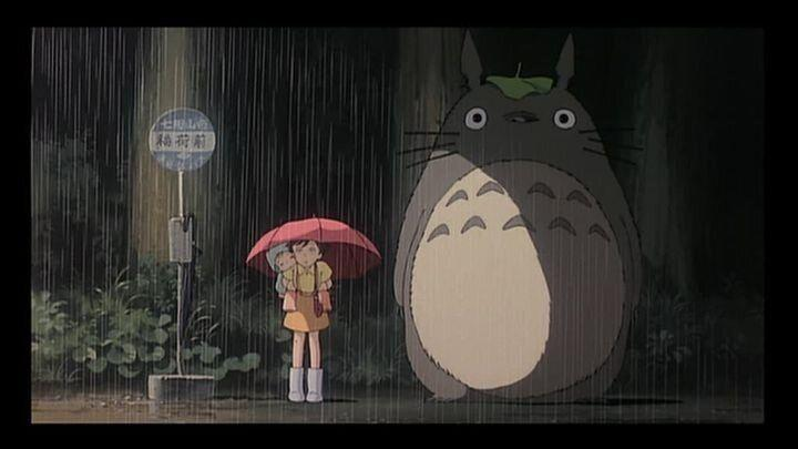 Satsuki and Mei wait for the bus alongside Totoro. (Studio Ghibli)