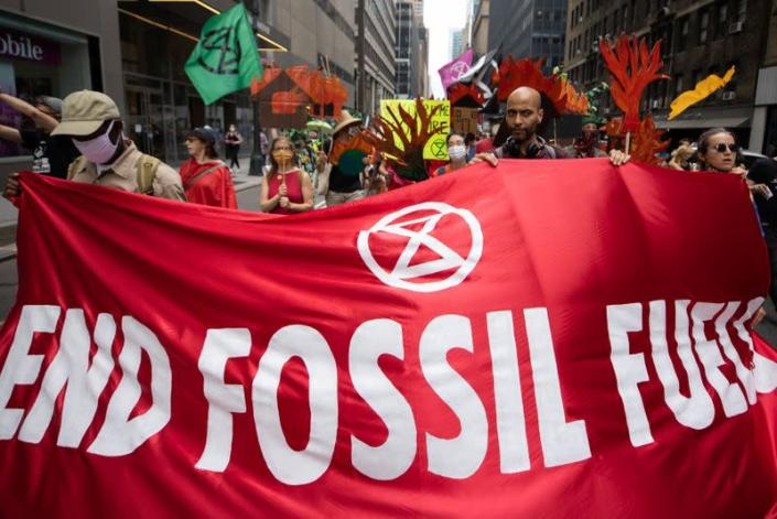 Extinction Rebellion holds a 'non-violent resistance' climate change protest in New York outside the New York Public Library