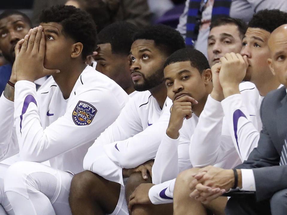 The Phoenix Suns bench watches the final seconds of the game during the second half of an NBA basketball game against the Portland Trail Blazers, Wednesday, Oct. 18, 2017, in Phoenix. The Trail Blazer won 124-76. (AP Photo/Matt York)