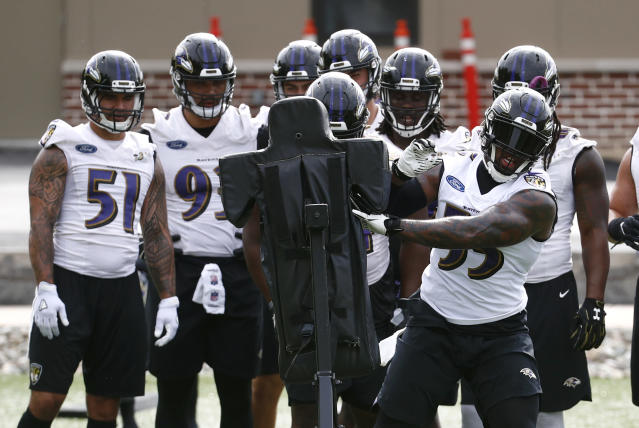 Baltimore Ravens linebacker Terrell Suggs, right, runs a drill in front of teammates during an NFL football practice at the team's headquarters in Owings Mills, Md., Wednesday, June 13, 2018. (AP Photo/Patrick Semansky)