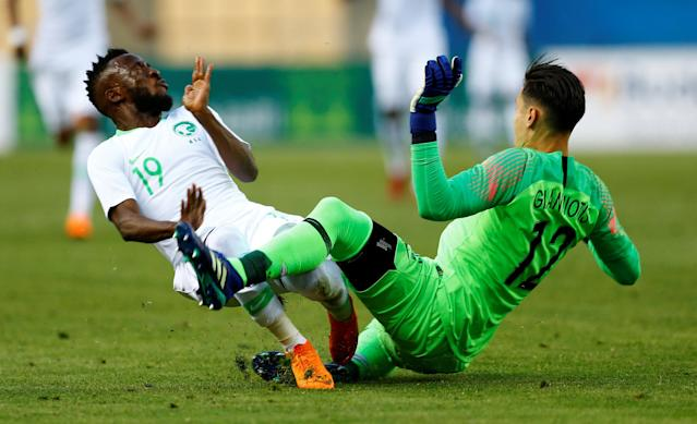 Soccer Football - International Friendly - Saudi Arabia v Greece - Estadio de La Cartuja, Seville, Spain - May 15, 2018 Greece's Andreas Gianniotis in action with Saudi Arabia's Fawaz Al-Qarni REUTERS/Marcelo Del Pozo