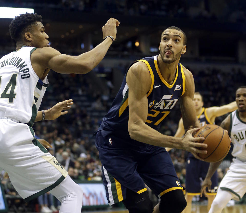 Rudy Gobert, right, reportedly suffered a sprained MCL in his left knee Friday. (AP)