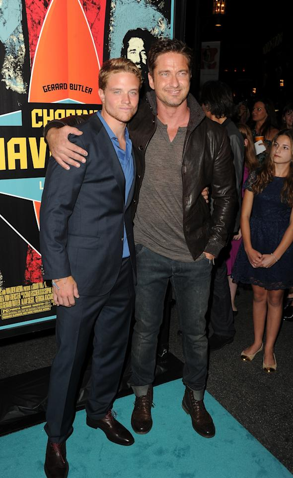 """LOS ANGELES, CA - OCTOBER 18:  Actors (L-R) Johnny Weston and Gerard Butler arrive at the premiere of 20th Century Fox's """"Chasing Mavericks"""" on October 18, 2012 in Los Angeles, California.  (Photo by Jason Merritt/Getty Images)"""
