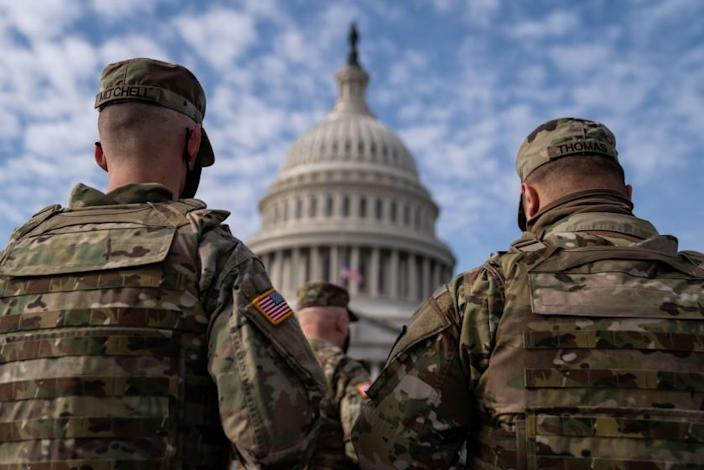 WASHINGTON, DC - JANUARY 17: Members of the National Guard in the plaza in front of the U.S. Capitol Building on Sunday, Jan. 17, 2021 in Washington, DC. After last week's riots and security breach at the U.S. Capitol Building, the FBI has warned of additional threats in the nation's capital and across all 50 states. (Kent Nishimura / Los Angeles Times)