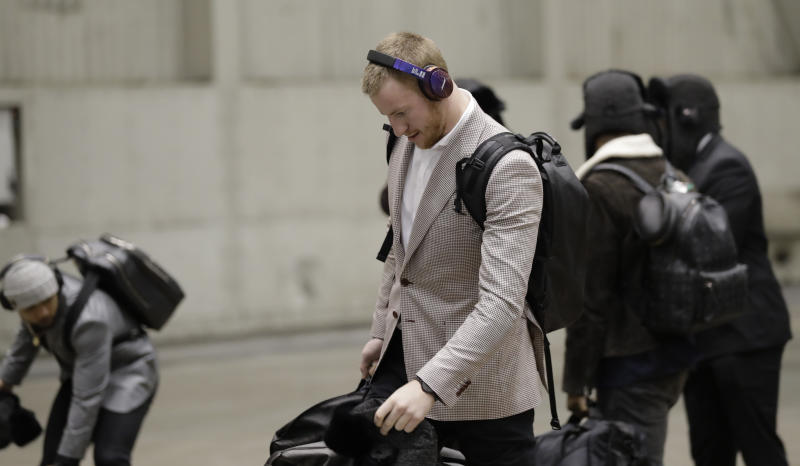 Injured Philadelphia Eagles quarterback Carson Wentz arrives with his teammates for the NFL Super Bowl LII. (AP)
