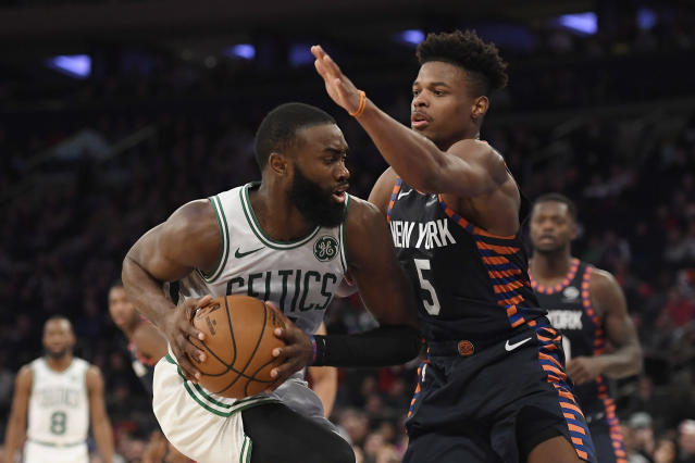 New York Knicks guard Dennis Smith Jr. (5) defends against Boston Celtics guard Jaylen Brown during the second half of an NBA basketball game, Sunday, Dec. 1, 2019, in New York. (AP Photo/Sarah Stier)