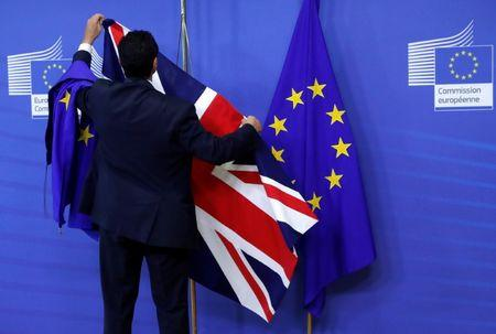 FILE PHOTO - Flags are arranged at the EU Commission headquarters ahead of a first full round of talks on Brexit, Britain's divorce terms from the European Union, in Brussels
