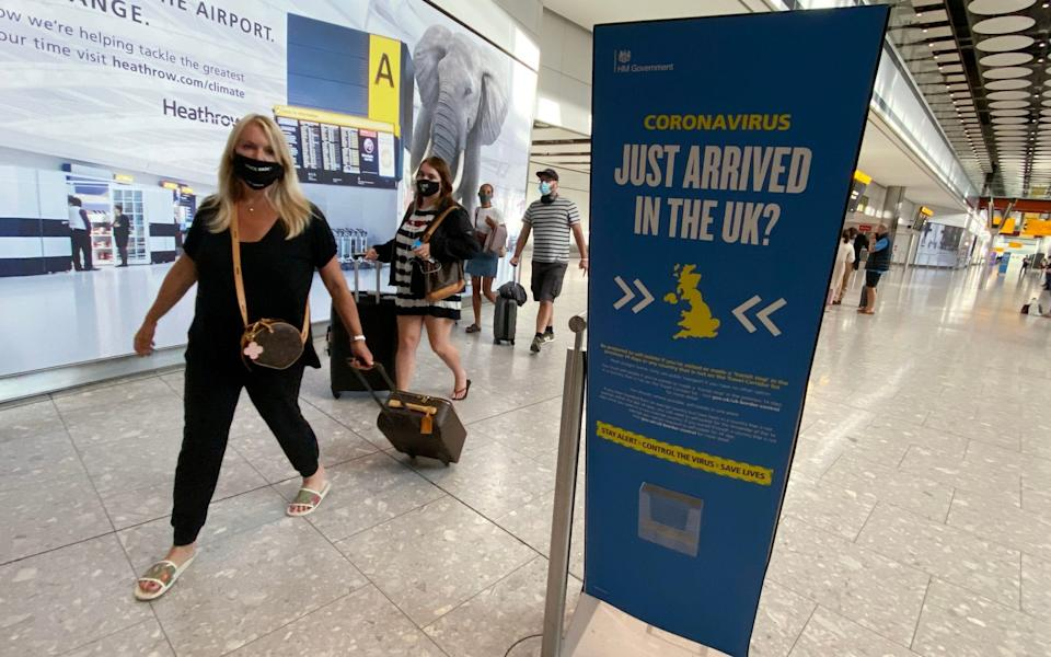Passengers returning to Heathrow Airport from Greece in September. Strict border controls and quarantines from all countries would be needed for virus elimination - Yui Mok/PA