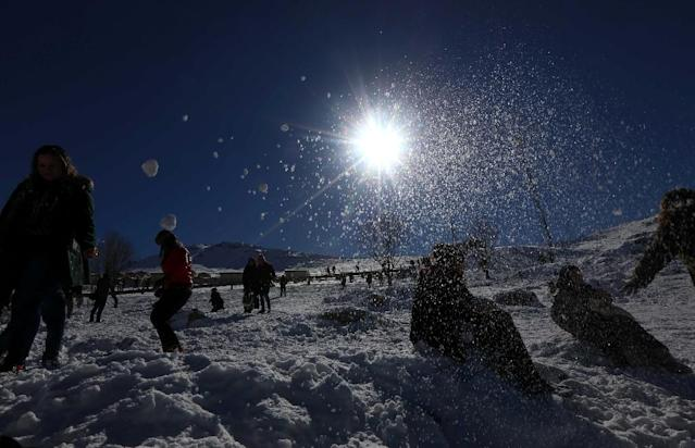 People play in the snow at the Korek Mountain resort near the city of Rawanduz in the Arbil Governorate of Iraqi Kurdistan on February 3, 2017 (AFP Photo/Safin HAMED)