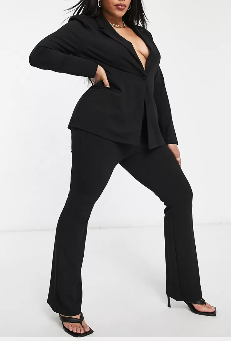 """<h2>Asos Design Curve Jersey Slim Kick Flare Suit Pant</h2><br>Who said workwear had to be uncomfortable? These jersey-knit flare pants from ASOS would insist otherwise. <br><br><em>Shop <strong><a href=""""https://www.asos.com/us/asos-curve/asos-design-curve-jersey-slim-kick-flare-suit-pant/prd/22044224?colourwayid=60345218&SearchQuery=plus+size+suits"""" rel=""""nofollow noopener"""" target=""""_blank"""" data-ylk=""""slk:ASOS"""" class=""""link rapid-noclick-resp"""">ASOS</a></strong></em><br><br><strong>ASOS DESIGN Curve</strong> ASOS DESIGN Curve jersey slim kick flare suit pant, $, available at <a href=""""https://go.skimresources.com/?id=30283X879131&url=https%3A%2F%2Fwww.asos.com%2Fus%2Fasos-curve%2Fasos-design-curve-jersey-slim-kick-flare-suit-pant%2Fprd%2F22044224%3Fcolourwayid%3D60345218%26SearchQuery%3Dplus%2Bsize%2Bsuits"""" rel=""""nofollow noopener"""" target=""""_blank"""" data-ylk=""""slk:ASOS"""" class=""""link rapid-noclick-resp"""">ASOS</a>"""