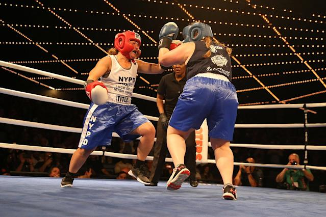 <p>Stacy Weinstein, left, goes on the attack against Katie Walsh during the NYPD Boxing Championships at the Theater at Madison Square Garden on June 8, 2017. (Gordon Donovan/Yahoo News) </p>