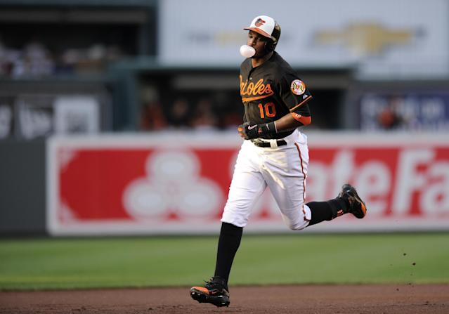 Baltimore Orioles' Adam Jones rounds the bases after hitting a two-run home run against the Boston Red Sox during the first inning of a baseball game on Friday, July 26, 2013, in Baltimore. (AP Photo/Nick Wass)