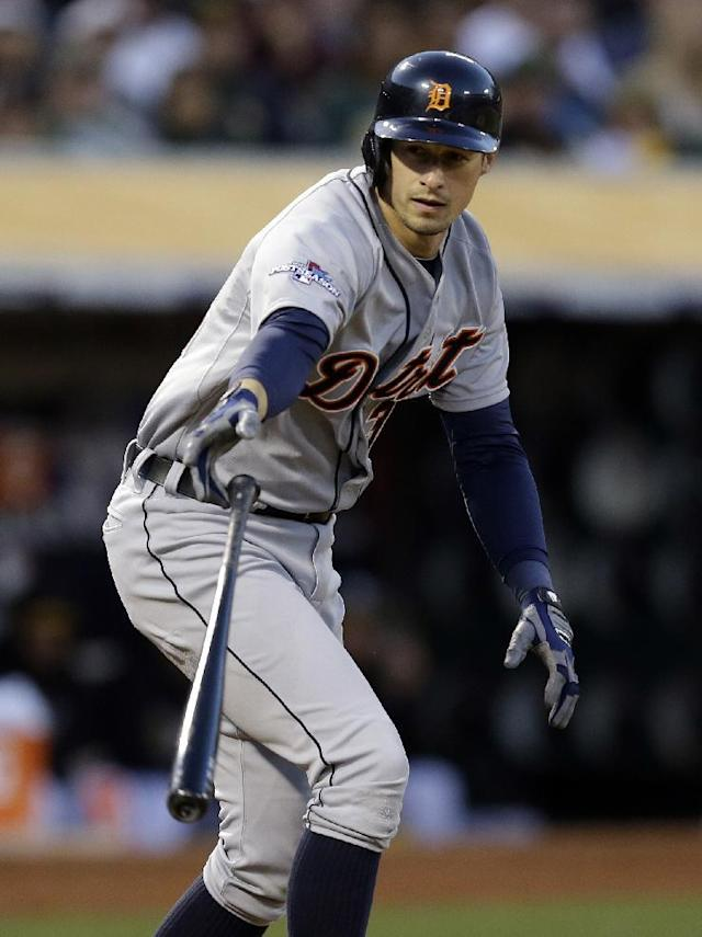 Detroit Tigers Don Kelly tosses his bat after being walked in the fifth inning of Game 5 of an American League baseball division series against the Oakland Athletics in Oakland, Calif., Thursday, Oct. 10, 2013. (AP Photo/Ben Margot)