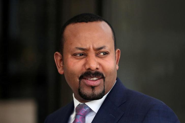 FILE PHOTO: Ethiopia's PM Ahmed waits for a meeting to start in Addis Ababa