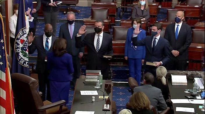 (Left to right) Democrats Raphael Warnock, Alex Padilla and Jon Ossoff take the oath of office administered by Vice President Kamala Harris in the Senate chamber on Wednesday. The three new senators and Harris' role as the Senate's presiding officer established Democrats as the chamber's majority. (Photo: Senate TV via REUTERS)
