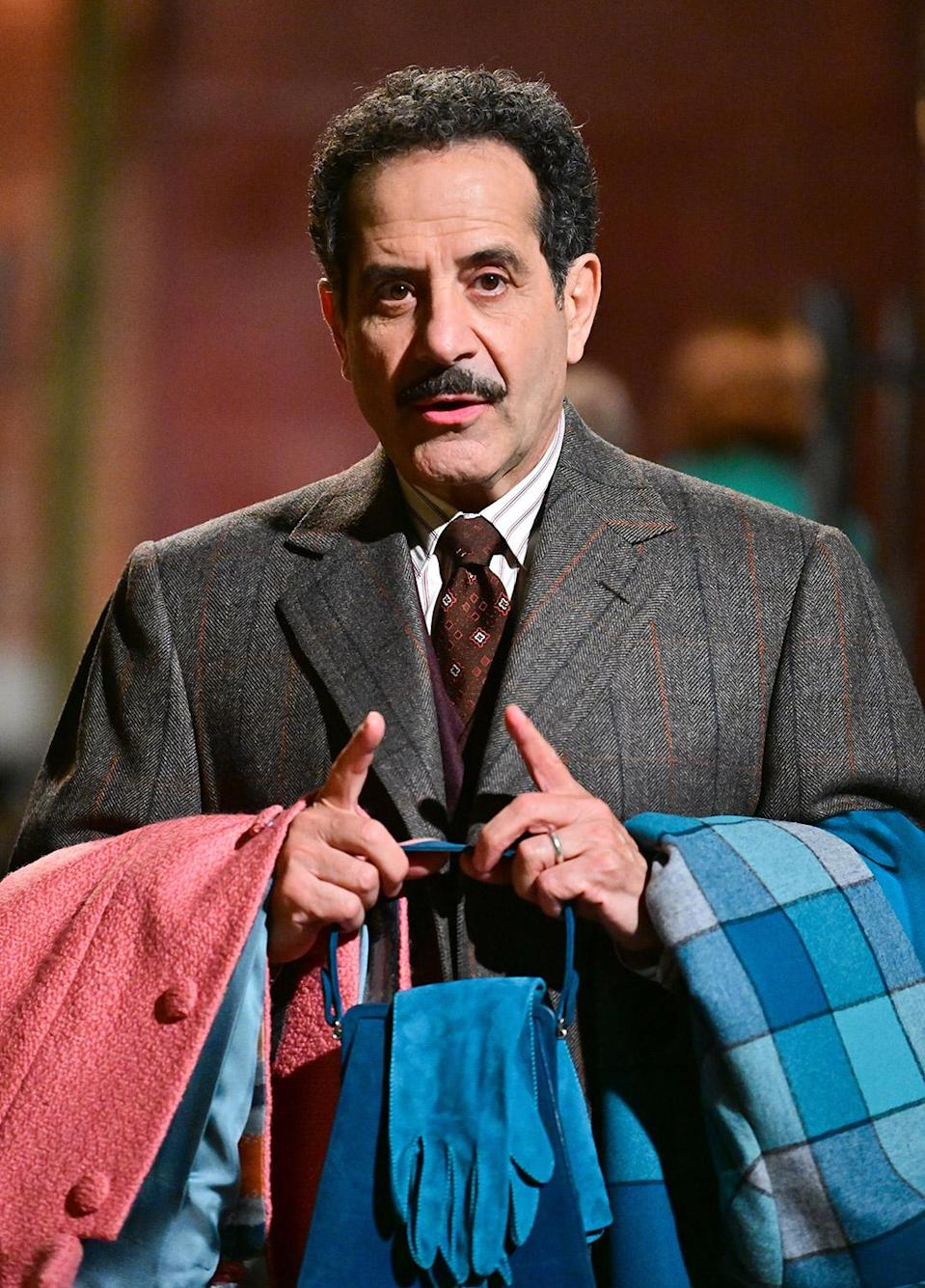<p>Tony Shalhoub, who plays Brosnahan's father in the series, carries some coats and accessories while filming on May 27. </p>