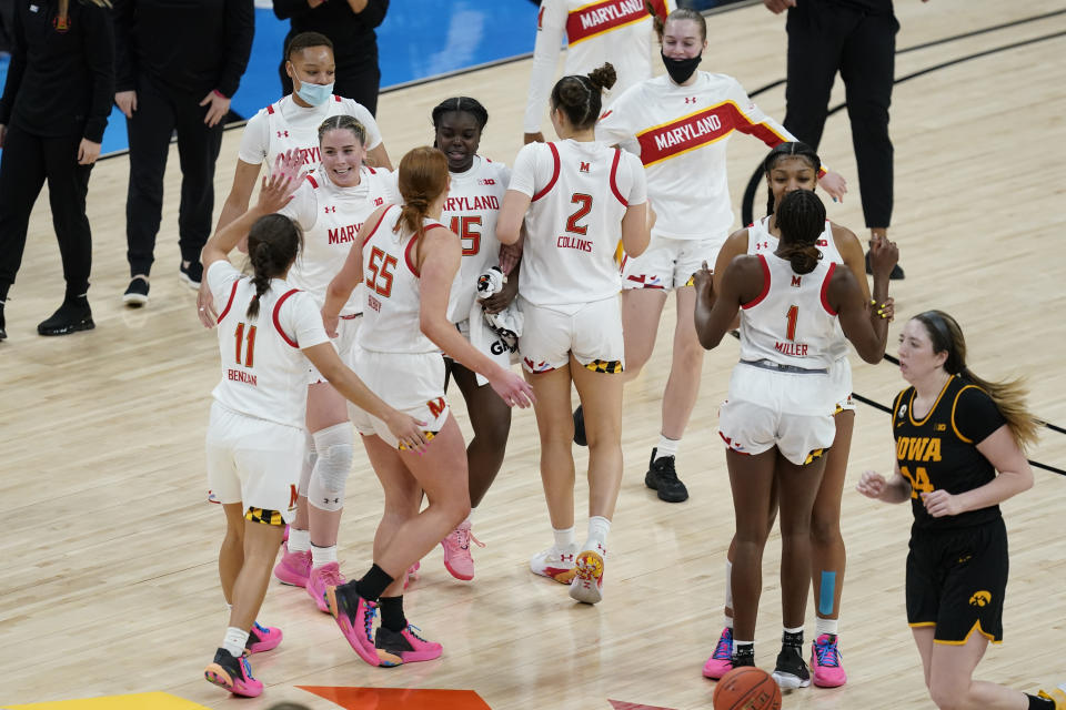 Maryland players react following a timeout by Iowa in the second half of an NCAA college basketball game in the championship of the Big Ten Conference tournament, Saturday, March 13, 2021, in Indianapolis. (AP Photo/Darron Cummings)