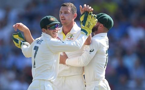 Josh Hazlewood of Australia celebrates taking the wicket of Jonny Bairstow of England with Tim Paine and Matthew Wade of Australia during Day Four of the 3rd Specsavers Ashes Test match between England and Australia at Headingley on August 25, 2019 in Leeds, England - Credit: Getty Images Europe