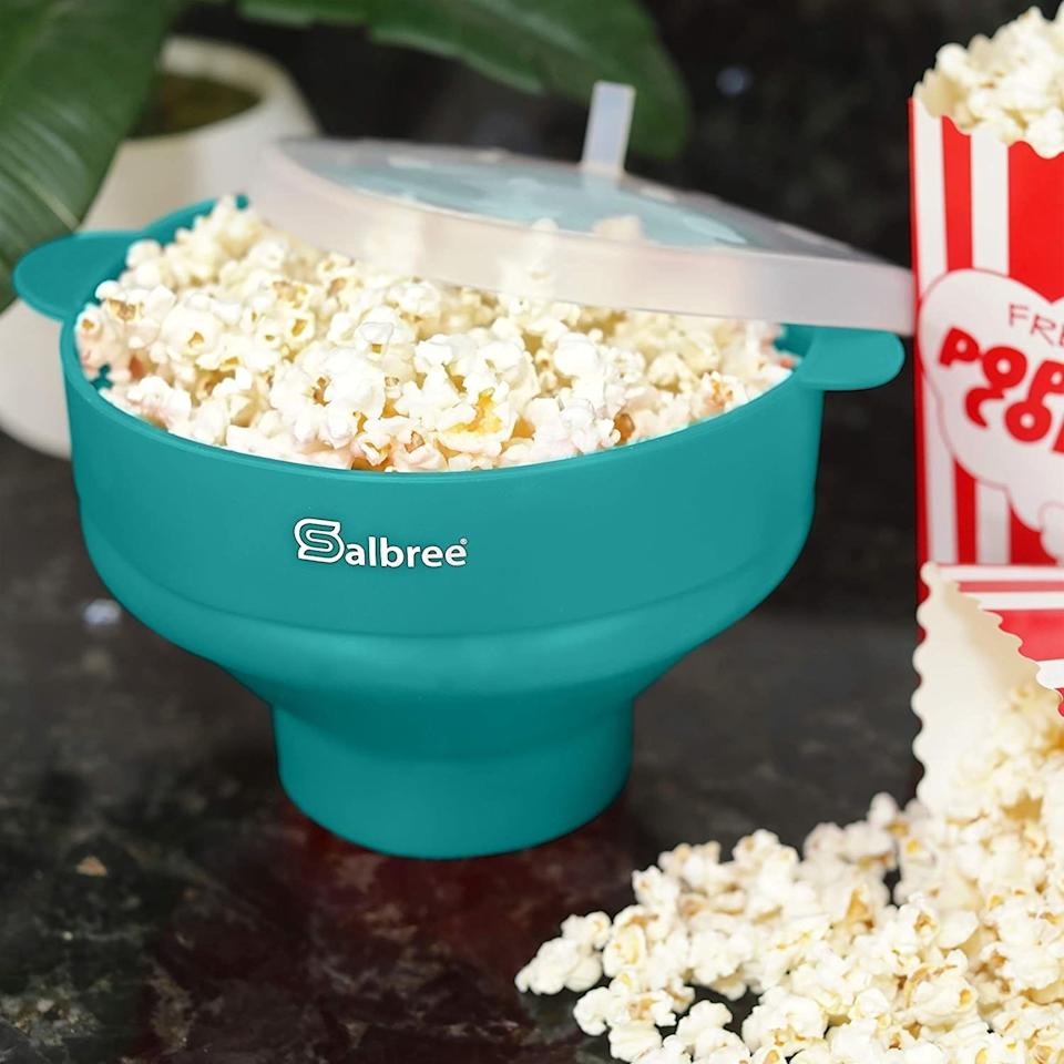 """Say goodbye to buying bags and bags of microwave popcorn. All you have to do is put kernels into this and pop it into the microwave, and you'll have delicious popcorn in minutes. It will go perfectly with all the Netflix shows you've been bingeing — mmm think of how good your house will smell.<br /><br /><strong>Promising review:</strong>""""This has changed my life. Instead of hauling out and warming up the air popper (which took forever and shot kernels across the room), I use this ingenious contraption and have popcorn in about three minutes. And this thing almost never leaves kernels un-popped. It's easy to clean too. I've bought it as a gift since purchasing for myself. Highly recommend."""" —<a href=""""https://www.amazon.com/dp/B072LTWNQD?tag=huffpost-bfsyndication-20&ascsubtag=5890048%2C32%2C36%2Cd%2C0%2C0%2C0%2C962%3A1%3B901%3A2%3B900%3A2%3B974%3A3%3B975%3A2%3B982%3A2%2C16492963%2C0"""" target=""""_blank"""" rel=""""noopener noreferrer"""">fox1at<br /></a><br /><strong>Get it from Amazon for<a href=""""https://www.amazon.com/dp/B072LTWNQD?tag=huffpost-bfsyndication-20&ascsubtag=5890048%2C32%2C36%2Cd%2C0%2C0%2C0%2C962%3A1%3B901%3A2%3B900%3A2%3B974%3A3%3B975%3A2%3B982%3A2%2C16492963%2C0"""" target=""""_blank"""" rel=""""noopener noreferrer"""">$15.90</a>(available in 23 colors).</strong>"""