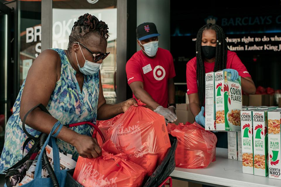 New Yorkers in need receive free produce, dry goods, and meat at a Food Bank For New York City distribution event at the Barclays Center on July 30, 2020 in New York City. (Photo by Scott Heins/Getty Images)