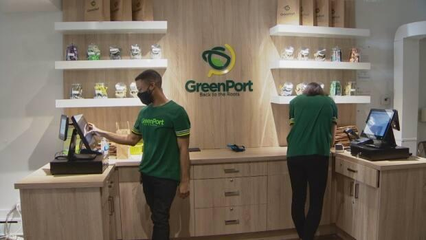 GreenPort Cannabis employees fill orders during the store's grand opening on Oct. 17, 2020.