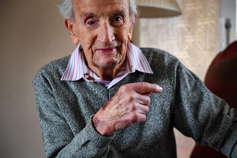 John Cox, 102, at his home in Lincoln, where he fought off a conman burglar who tried to gain access on Tuesday.
