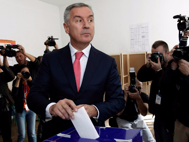 Montenegrin Prime Minister and leader of ruling Democratic Party of Socialists, Milo Djukanovic, casts his ballot at a polling station in Podgorica, Montenegro, October 16, 2016. REUTERS/Stevo Vasiljevic