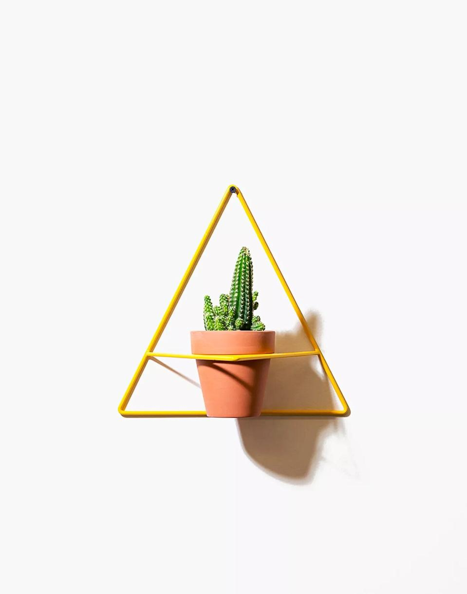 """<h3>Madewell NEWMADE LA Triangle Wall Planter</h3><br>""""A nice wall planter will connect and ground the airy sign with the earth,"""" Stardust says. """"It'll inspire Libra to embrace nature.""""<br><br><strong>Madewell</strong> NEWMADE LA Triangle Wall Planter, $, available at <a href=""""https://go.skimresources.com/?id=30283X879131&url=https%3A%2F%2Fwww.madewell.com%2Fnewmade-la-triangle-wall-planter-L9571.html"""" rel=""""nofollow noopener"""" target=""""_blank"""" data-ylk=""""slk:Madewell"""" class=""""link rapid-noclick-resp"""">Madewell</a>"""