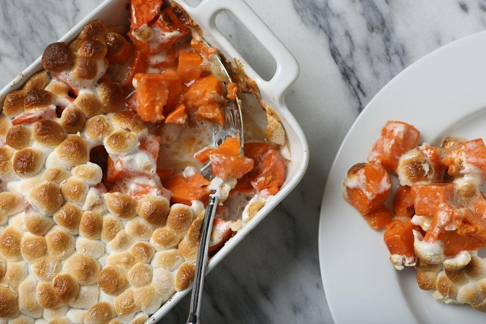"""<p>Sweet potato casserole, or sweet potatoes baked with toasted marshmallows and plenty of brown sugar, is a Thanksgiving favorite (how could it not be?). The sweet potato itself has been around since the country was born—<a href=""""https://www.smithsonianmag.com/smart-news/happy-100-birthday-marshmallow-sweet-potato-180967245/"""" rel=""""nofollow noopener"""" target=""""_blank"""" data-ylk=""""slk:Columbus"""" class=""""link rapid-noclick-resp"""">Columbus</a> brought them back to Spain after going to America. </p><p>As for sweet potatoes topped with marshmallows? That didn't become a popular recipe until 1917, when it was created by a company called Angelus Marshmallows (the original maker of Cracker Jacks). According to <em><a href=""""https://www.saveur.com/article/Kitchen/thanksgiving-sweet-potato-casserole/"""" rel=""""nofollow noopener"""" target=""""_blank"""" data-ylk=""""slk:Saveur"""" class=""""link rapid-noclick-resp"""">Saveur</a></em>, the company was trying to make marshmallows popular, so they put out a cookbook in 1917 that included sweet potatoes topped with them, and it stuck!</p>"""