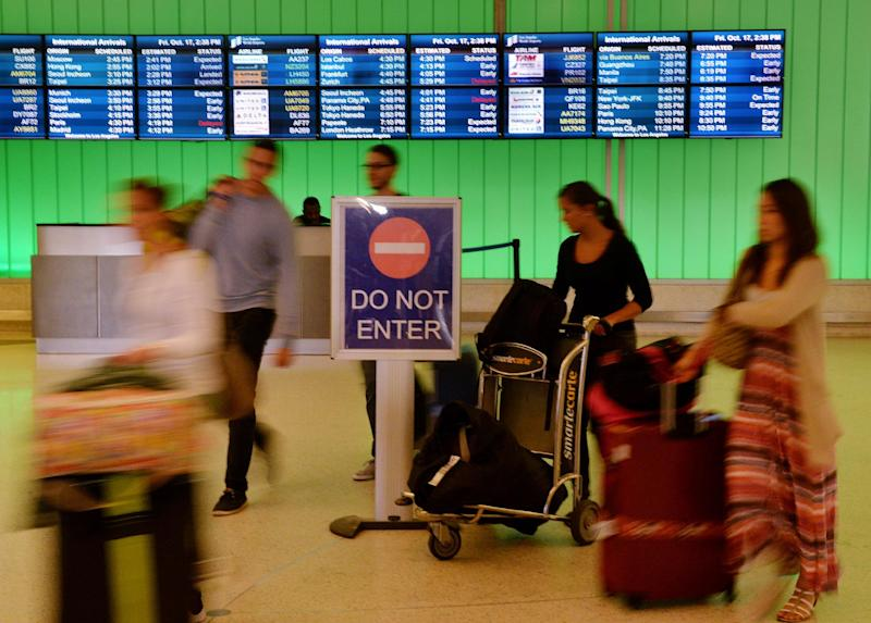 Passengers arrive at Los Angeles International Airport on October 17, 2014 as fear of the Ebola virus continues to grow (AFP Photo/Mark Ralston )